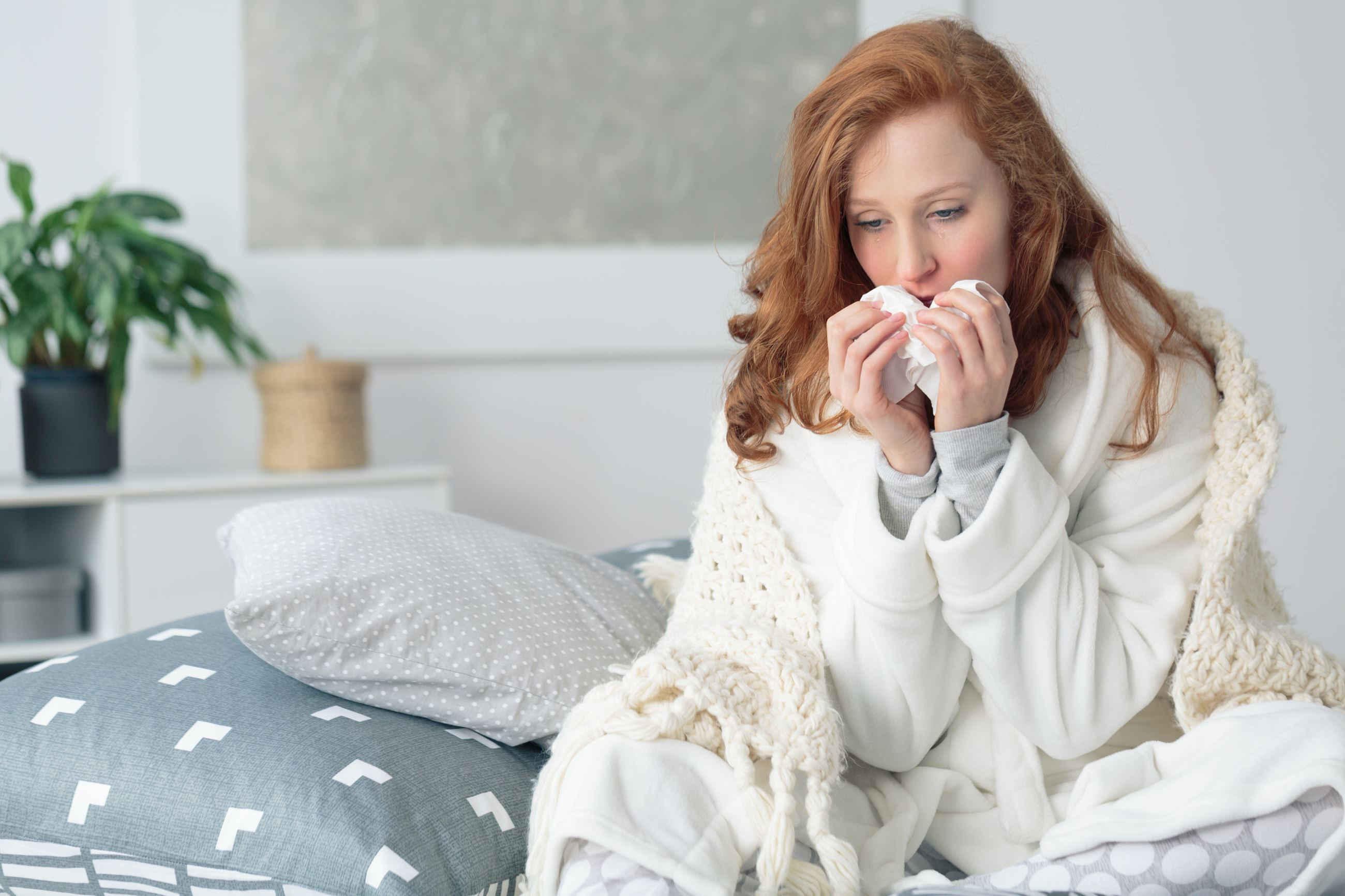 woman coughing in bed Opens in new window